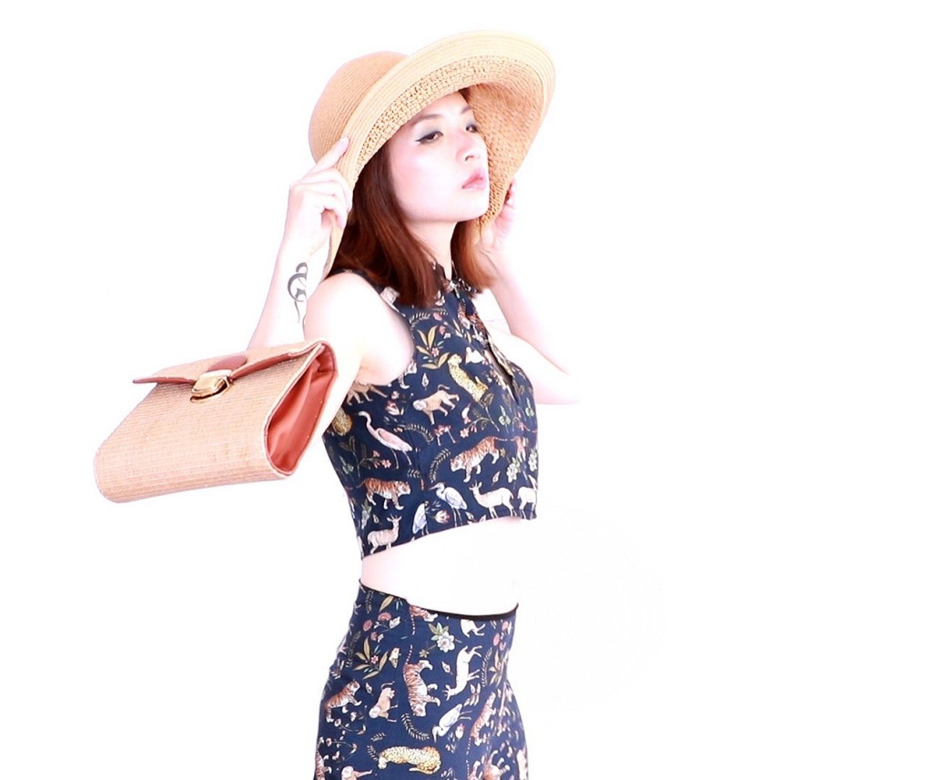 girl with straw hat and straw bag